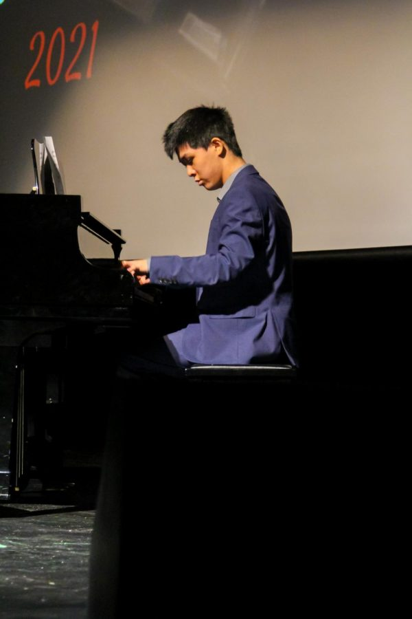 Senior Eric Wang plays the piano. Wang played the piano and gave a presentation on the budget for his talent.