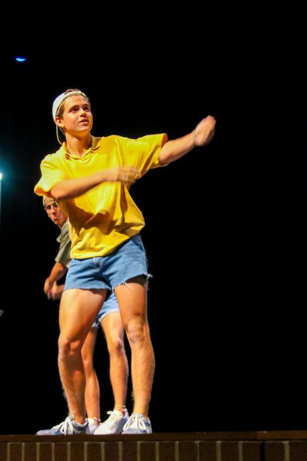 Senior Connor Dunn swings his arms during the dance section of his talent. Dunn also had a video presentation.