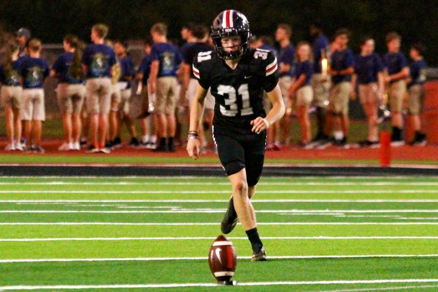 Junior kicker no. 31 Caden Carlock runs up to the ball to kick a field goal. The successful field goal got the Leopards ahead to a score of 51-0.