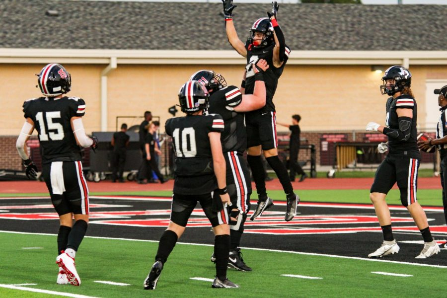 Sophomore offensive lineman no. 61 Sam Reynolds lifts up junior wide receiver no. 2 Jaxson Lavender. This celebration took place after Lavender scored the Leopards seventh touchdown of the game.