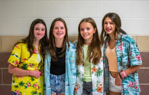 Freshmen Emma Tomlin, Brooke Striplin,  Finley Horton, and Emily Allen dressed up for Bikers vs. Surfers day. They all chose to dress up as surfers with Hawaiian shirts.