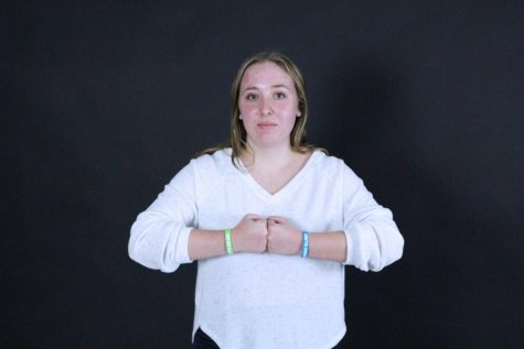 Senior Ainsley Sullivan created allergy bracelets. Sullivan is selling these bracelets to promote allergy awareness as a part of her senior project.