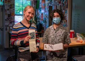 Seniors Jenna Garcia and Ella Reaugh recived perfect scores on their AP Art exam this past year. Both are holding their art book studies, where they deeply study nature as they draw it.