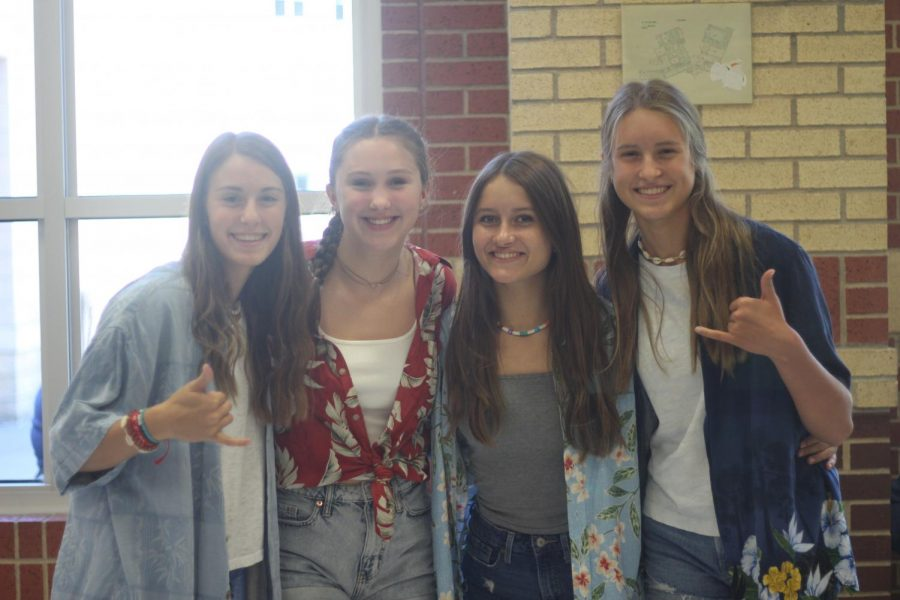 Sophomores Lauren Dolberry, Avery Hammett, Julie Snow, and Mallory Ansley dress up for Surfers vs. Bikers day. The four dress up in Hawaiian shirts.