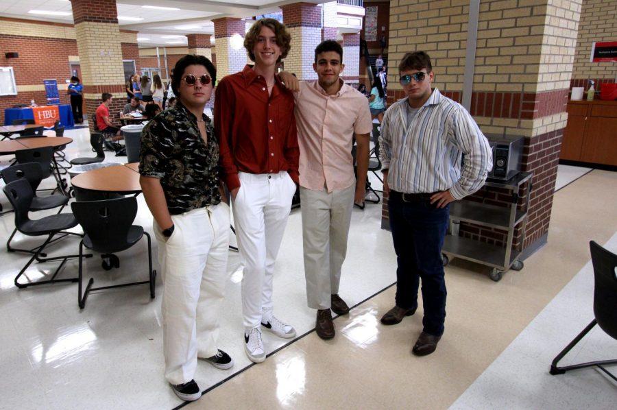 Juniors Bruno Carretti, Fletcher Boots, Daniel Malka, and Rob Philips take a photo in their seventies attire. Tomorrow's theme is Surfers v. Bikers.