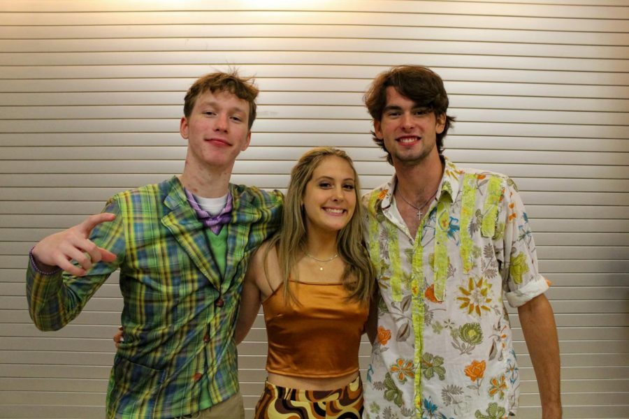 Seniors Garrett Norwood, Ava Comacho, and Pete Peabody dress up in their 70's gear. The theme for Tuesday was 70's or '70s.