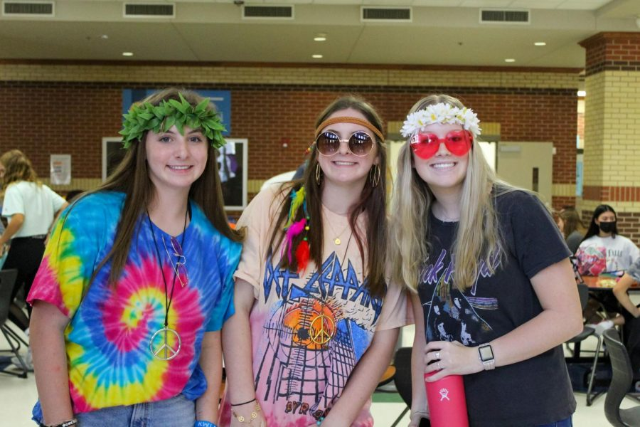 Freshman Izzie Stein and Sophie Stein pose with sophomore Kate McGrath. Their outfits consist of fun glasses and band t-shirts.