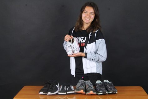 Senior Sydnee Taylor shows off the shoes she has collected. Taylor is coordinating a shoe drive for her senior project.