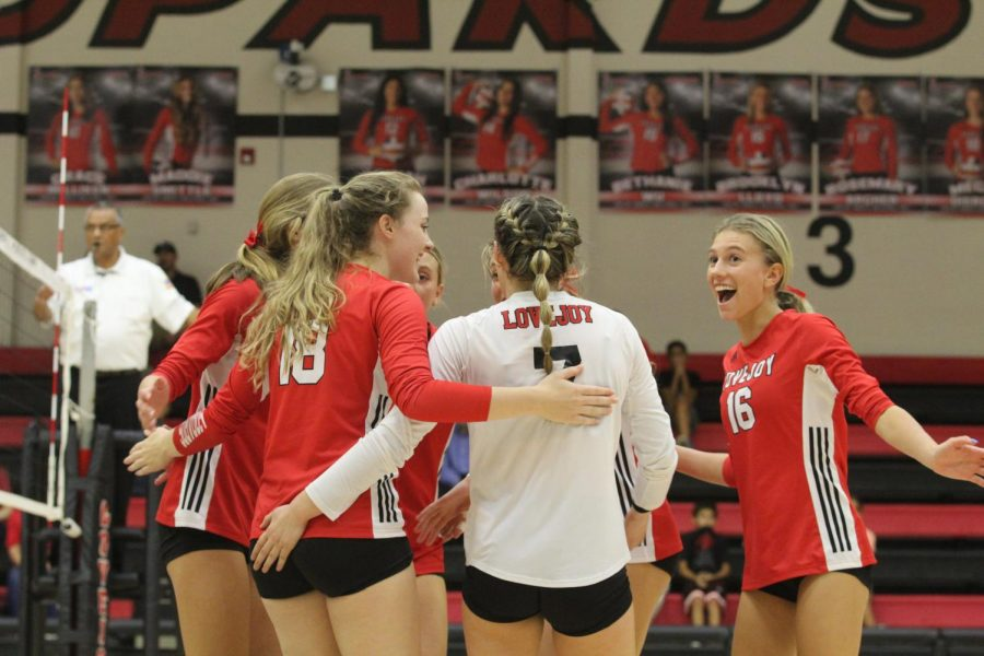 The Leopards celebrate as senior outside hitter no. 18 Megan Dierecks scores a point. The Leopards played against the Colony and won all three sets.
