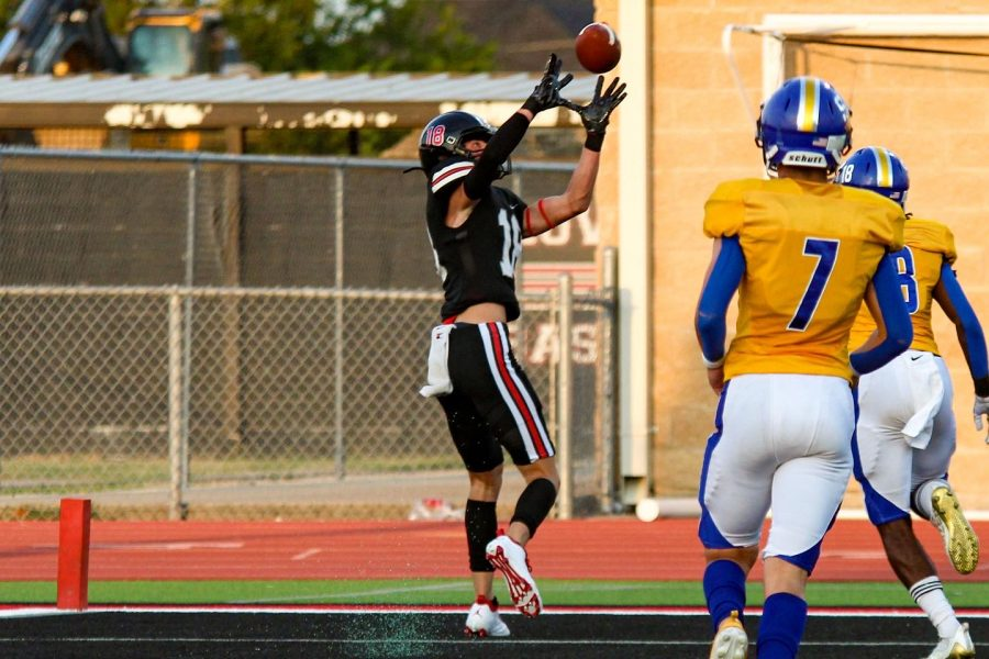 Sophomore wide receiver no. 18 Parker Livingstone catches the ball for a Leopard touchdown. The Leopards then lead the game 22-0.