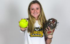 Junior Hannah Harvey holds out a softball. Harvey committed to Kennesaw State University on September 26th.
