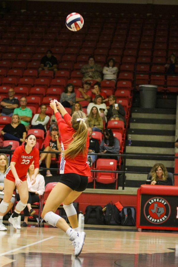 Senior setter no. 17 Rosemary Archer bumps the ball up for senior setter no. 9 Averi Carlsons set. Archer had 16 assists .