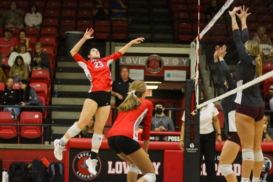 Senior hitter no. 23 Lauran Richards jumps up for a kill. The Leopards are currently 9-1 in the district season.
