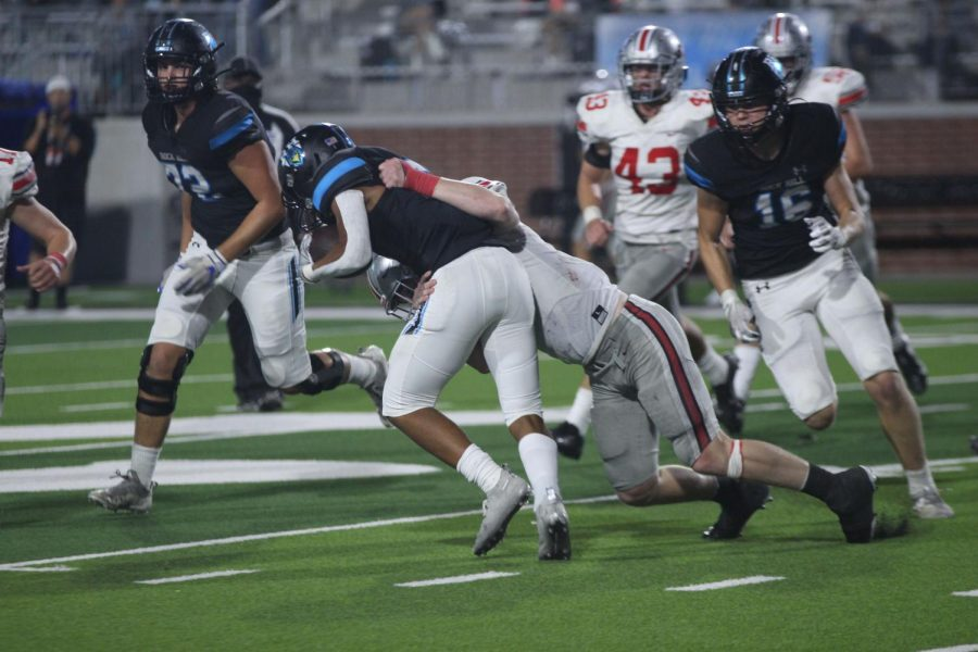 Junior linebacker no. 44 Bennett Slaughter tackles a Rock Hill running back. The Leopards beat the Blue Hawks with a final score of 55-14.