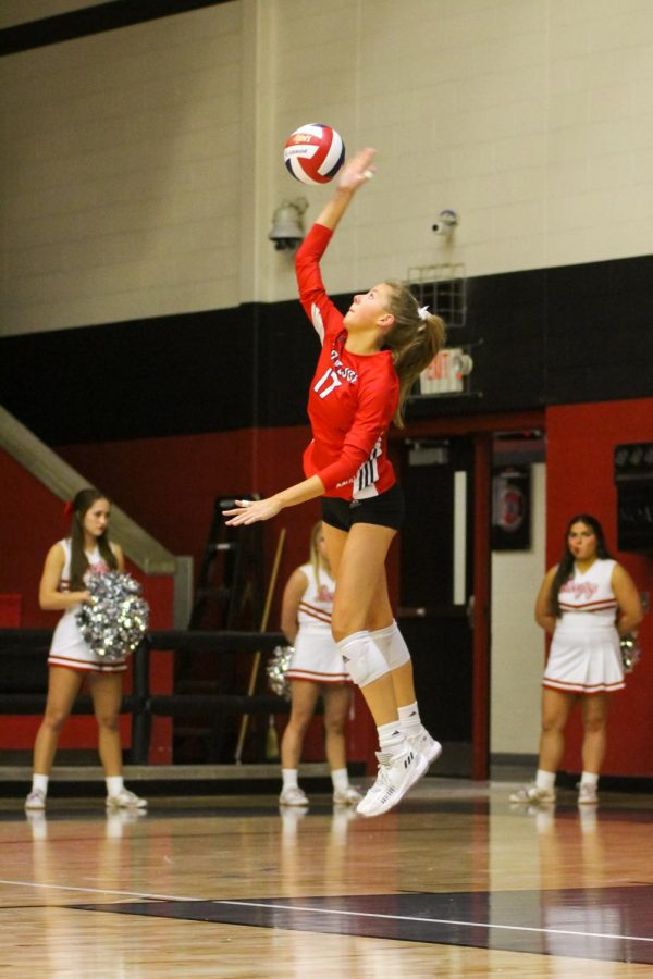 Senior setter no. 17 Rosemary Archer serves the ball. The Leopards won the first set 25-8.