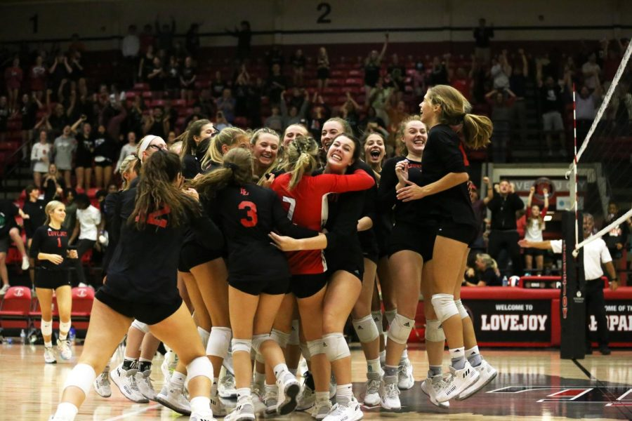 The volleyball team celebrates after winning the fifth set against the McKinney North Bulldogs. The game was the last home game this season for the team.