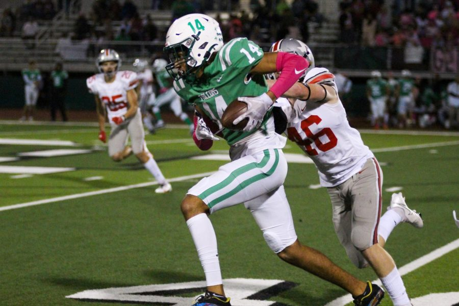 Junior defensive back no. 46 Thomas Harp pushes Lake Dallas junior wide receiver no. 14 Evan Weinburg. The Leopards won the game with a final score of 55-7.