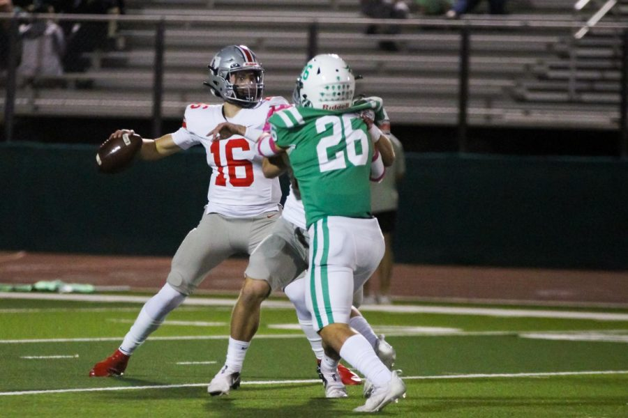 Junior quarterback no. 16 Brayden Hagle throws the ball. The Leopards had a total of 495 yards in the game.