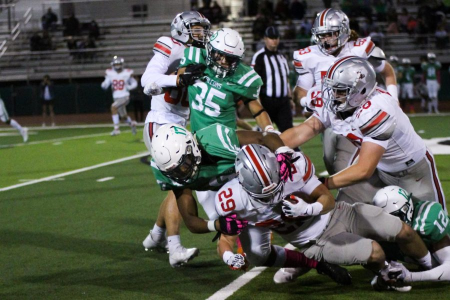 Junior running back no. 29 Mason Wallace gets tackled after a run. Wallace rushed for 10 yards in the game.