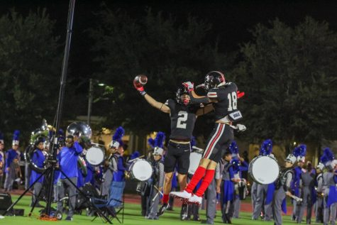 Junior wide receiver no. 2 Jaxson Lavender and sophomore wide receiver no. 18 Parker Livingstone celebrate. Lavender had scored a touchdown giving the Leopards a score of 21-0 in the second quarter.