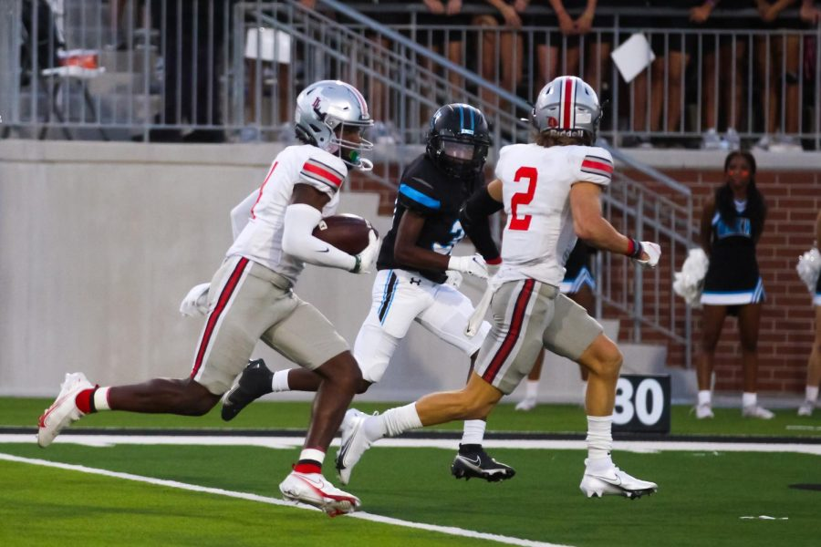 Junior wide receiver no. 4 Kyle Parker runs the ball past the 30 yard line. Parker received for 188 yards.