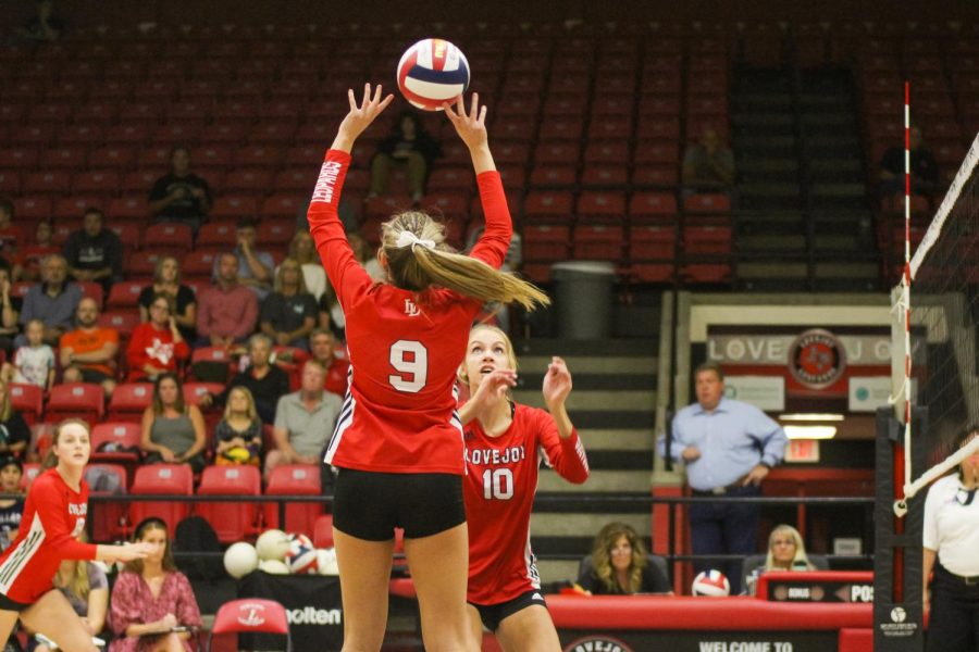 Senior setter no. 9 Averi Carlson sets the ball up for senior hitter no. 18 Meghan Diercks. The Leopards won the third set with a final score of 25-16.