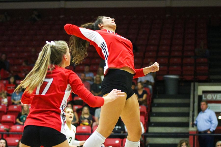 Sophomore hitter no. 12 Hannah Gonzalez jumps up for a hit. The Leopards won the first set 25-15.