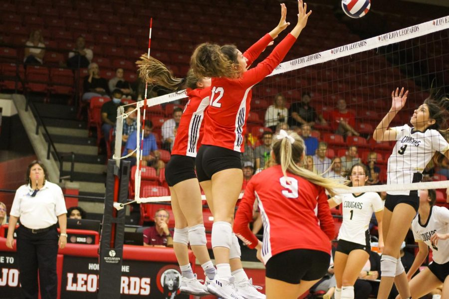 Senior hitter no. 8 Elizabeth Ponder and sophomore hitter no. 12 Hannah Gonzalez jump up to block the ball. The Leopards will play Wylie East on Friday.