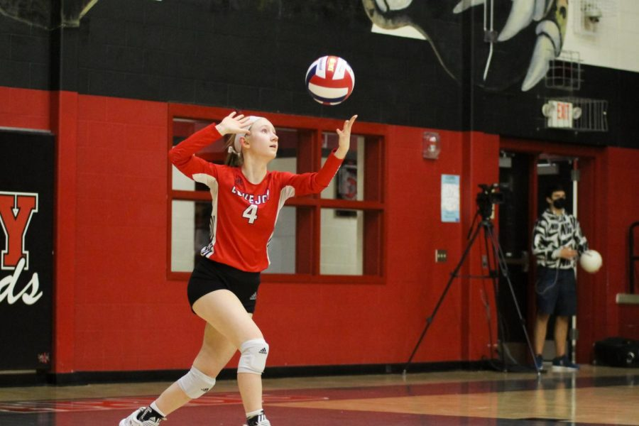Senior defensive specialist no. 4 Maci Perkins serves the ball. The Leopards won the second set with a final score of 25-12.