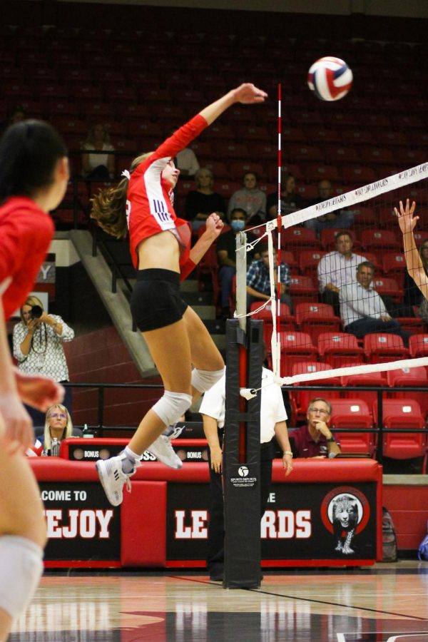 Senior hitter no. 10 Grace Miliken jumps up for a hit. Miliken is committed to Boston College.
