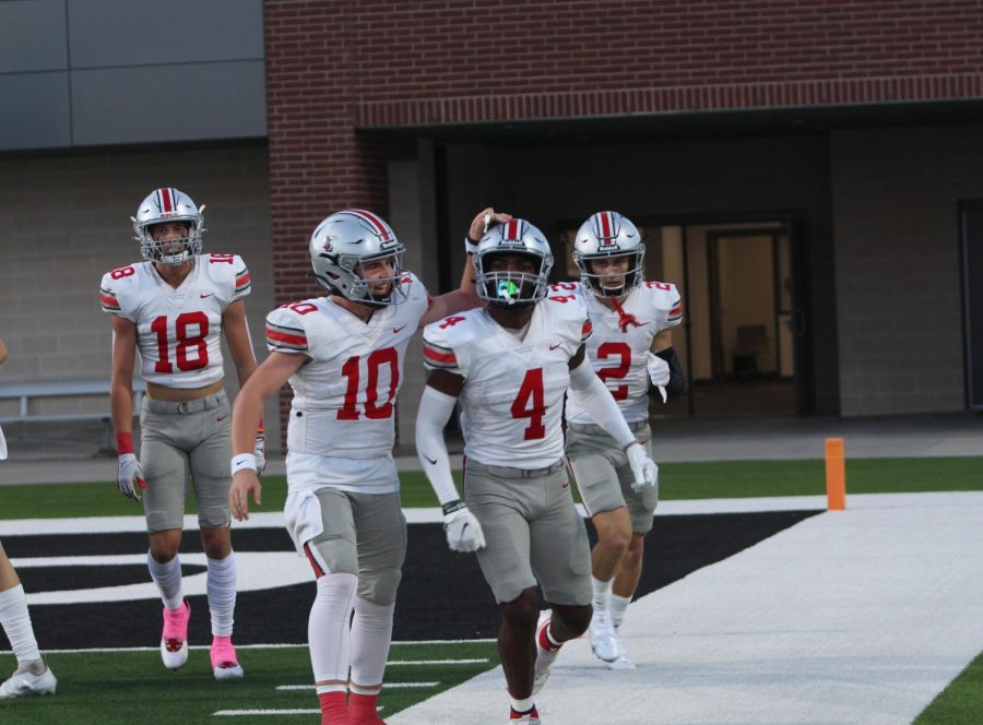 Sophomore quarterback no. 10 Alexander Franklin congratulates junior wide receiver no. 4 Kyle Parker on his touchdown. The Leopards are 5-0 for the overall season.